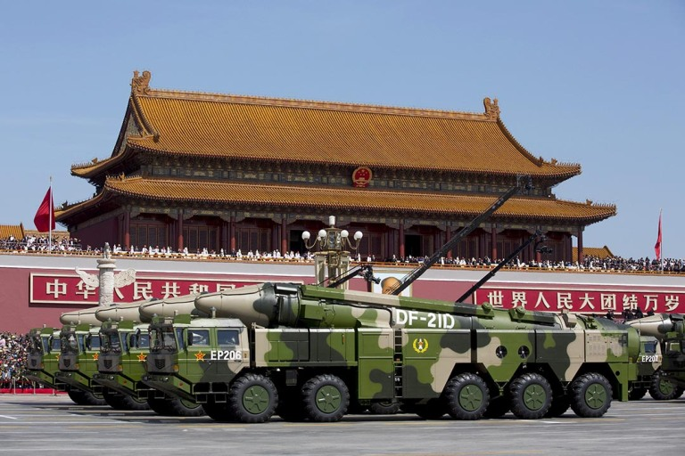 Chinese military vehicles carrying DF-21D anti-ship ballistic missiles, potentially capable of sinking a U.S. Nimitz-class aircraft carrier in a single strike, travel past Tiananmen Gate during a military parade to commemorate the 70th anniversary of the end of World War II in Beijing Thursday Sept. 3, 2015. REUTERS/Andy Wong/Pool      TPX IMAGES OF THE DAY